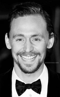 Tom Hiddleston's smile is contagious