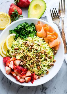 Smoked Salmon and Strawberry Zucchini Noodle Pasta Salad! A healthy lower carb Zucchini noodle pasta salad with a creamy avocado sauce and paired with the fresh strawberries, spinach, and smoked salmon. This gluten free Salad bowl is perfect for a spring or summer lunch or side dish.