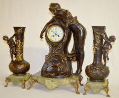 Antique Frenin A. Ranieri 3 Piece Statue Clock with A.D. Mougin Movement: The spelter statue is of a girl trying to catch a dragonfly. There are 2 matching side pieces signed L&F Moreau with a Paris France foundry mark. The clock has a porcelain decorated dial, the key and pendulum and a signed A.D. Mougin movement #4814. The clock is signed A. Ranieri and is mounted on a green onyx base. The matching cherub side statues are also mounted on green onyx bases. Has not been tested. Sells as…