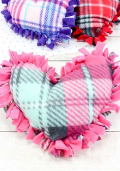 These valentine pillows are so easy to make! They use the classic summer camp fleece tie pillows method and are the perfect Valentine's Day crafts for tweens and big kids. Valentine Crafts For Kids, Crafts For Kids To Make, Easy Diy Crafts, Valentines Diy, Crafts For Teens, Kid Crafts, Preschool Crafts, Holiday Crafts, Paper Crafts