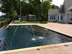 Inifinity Edge pool overlooking Lake Erie and custom Unilock patio in Rocky River, Ohio.