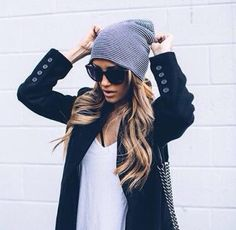 A blazer, loose v-neck shirt, and a beanie with big black sunglasses to compliment the look.