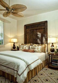 old door as headboard in this bedroom designed by Sandra Espinet -