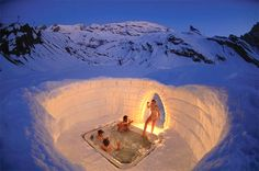 Swiss Alps, the Iglu-Dorf Hotel is carved entirely out of snow yet keeps guests warm with hot tubs, steamy saunas, and mulled wine