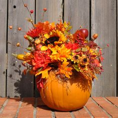 Pumpkin Floral Arrangement: for one of the centerpieces (lots more dark red flowers though)