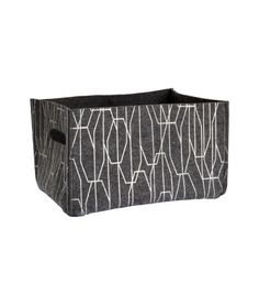 Rectangular storage basket in print felt with cut-out handles on the short sides. Size 20x23x32 cm.