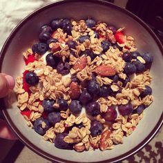 Healthy diet = healthy baby! Organic strawberries and blueberries, Greek lowfat vanilla yogurt, and organic almond crunch granola... Perfect pregnant meal :)