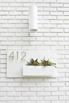 Get your dream home for less with these 100 DIY projects that will help you to upgrade your home.: DIY Modern House Number Planter