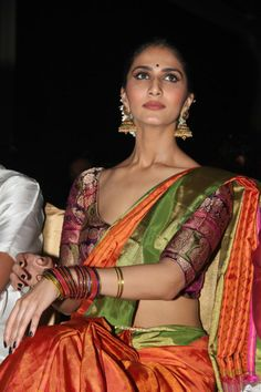 Vani Kapoor looks absolutely sexy in this traditional. Check out the wide neck blouse