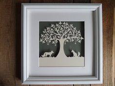 This stunning piece has been hand cut, from cream hammered paper, using a scalpel. Mr and Mrs Fox are under a tree, with little stars hanging