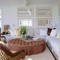 Vincente Wolf via Mark D. Sikes' blog; wicker chair; tufted ottoman; white sofa. I love it except for the ottoman