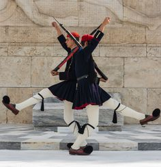 Two Evzones of the greek army, crossing in front of the tomb of the Unknown Soldier, Athens, Greece.
