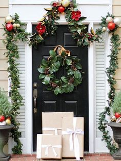 magnolia leaf wreath and garland. Bright ornaments in red, silver, and gold tones add a pop of color to decor.