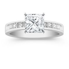This is my REAL wedding ring I have and I LOVE IT!!!! My Hubby did a great job picking it out all on his own!!!! Princess Cut Diamond Engagement Ring!
