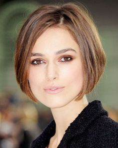 Keira Knightley's graphic bob emphasizes her face shape, while the side part adds lift to the choppy layers.