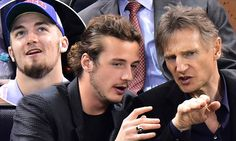 Liam Neeson enjoys quality time with his sons at ice hockey game