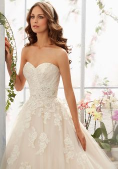 Embroidered Lace Appliques Net Dress with Scalloped Hemline Over Soft Satin.Treat yourself to this spectacular designer wedding dress with crystal beading.