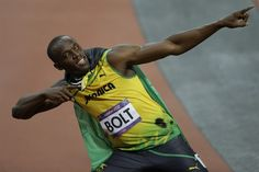 "Usain Bolt in his ""To The World"" pose after winning the men's 100m."
