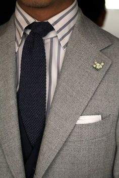 Layering of different textures and patterns. Bold stripes against subtle textures in neutrals.