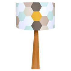 This lovely wooden lamp in soft, modern colours is hand crafted in North East England. The solid hardwood lamp base together with the contemporary hexagon design in shades of blue, grey, mustard and brown lampshade makes a simple lighting statement f.