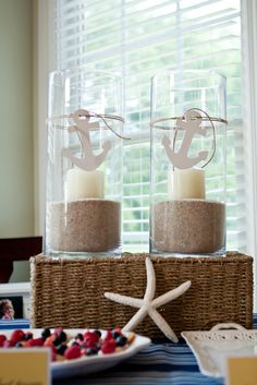 Love the candles with sand and anchors. Maybe starfish or sand dollars instead of anchors