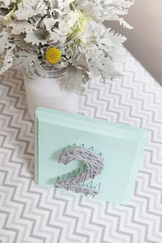 Make sure wedding guest can find their tables with DIY string art table numbers.