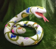 """Ssylvia"" is a needle and wet felted snake covered with white alpaca, and decorated with colorful wool and hand beading (by Kathleen Dodge-DeHaven)."