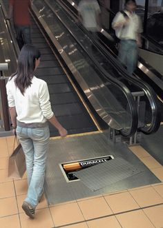 Duracell Escalator Advertisement -   Stickers of half covered Duracell battery compartments were placed at the start of escalators in major shopping malls