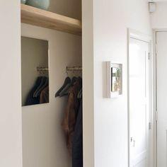 Very cute hidden hallway storage. Hides coats and gives a nice shelf for some display. Modern Corridor, hallway & stairs by Jolanda Knook interieurvormgeving Hallway Storage, Tall Cabinet Storage, Beaded Curtains Doorway, Interior Design Trends, Wardrobe Closet, House Entrance, Storage Hacks, Prefab Homes, Home Look