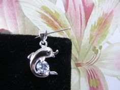 'Dolphin Dangling Pendant' is going up for auction at  7pm Thu, Feb 28 with a starting bid of $5.