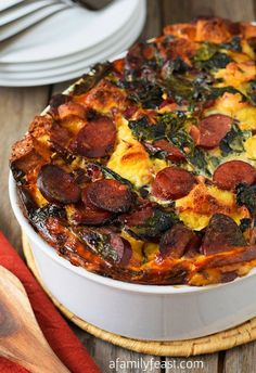 Turkey Kielbasa and Baby Kale Strata - Caramelized Polish sausage, creamy cheese and healthy baby kale baked together in a light soft bread strata. So delicious!