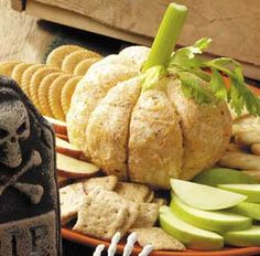 Indent cheese ball with a knife; add celery for the pumpkin stem.