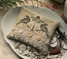 With thy Needle & Thread - love the lace and buttons; cross stitch sampler