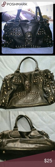 MG Collection- Skull bag This is a bowler style purse. Black with skull. Good condition, slight fraying on straps as shown in picture. Compact enough in size that is is comfortable and stylish to carry, but can fit a crap ton of stuff inside. MG Collection Bags