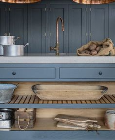 Farrow & Ball Down Pipe painted oak cabinets in an industrial shaker style showroom kitchen. The island has a polished concrete worktop and open shelving with slatted wood. The hanging industrial pendant lights from Original BTC and the bespoke copper tap Shaker Style Kitchens, Shaker Kitchen, New Kitchen, Home Kitchens, Country Kitchen, Kitchen Wood, Kitchen Paint, Kitchen Showroom, Kitchen Interior
