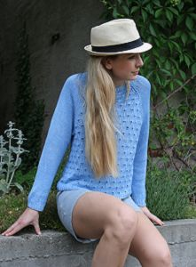 Peacock Sweater for Summer - Create a cute summer look with this Peacock Sweater for Summer. This gorgeous free knitting pattern shows you how to knit a sweater you are going to adore all summer long. The beautiful peacock feather pattern on the front makes this DIY sweater breathable, and perfect for cooler summer days.