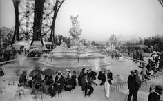 Fair spectators sitting under the Eiffel Tower, at the c.1889 Exposition Universelle in Paris. ~~ {cwl} ~~ (Image: Cultural Institute)