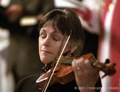 Violinist, Nancy Dinovo, cries while playing during a service at Christ Church Cathedral in downtown Vancouver for the September 11 victims.