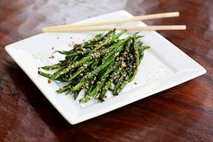 Sautéed green beens, loaded with garlic and sesame...  super simple, healthy and packed full of flavor!