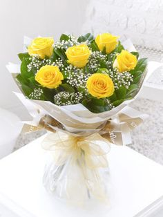 Six Stolen Kisses - Yellow C00271YS This chic, classic bouquet showcases the very finest large headed yellow roses beautifully. The roses and gypsophila complement each other perfectly, and the elegant wrap and ribbon add a sophisticate http://www.MightGet.com/january-2017-12/six-stolen-kisses--yellow-c00271ys.asp