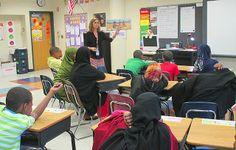 "Teacher Stephany Jallo reading the book ""Wiil Waal"" to the class."