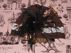 Cheetah Hat with Black Ostrich Feather and decor box. $20.00, via Etsy.