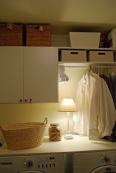 Love the wood turned shelf over the washer and dryer!  So smart and simple, and adds a lot more space and I just love it!