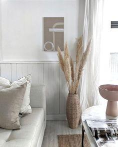 Scandinavian desgin with pampas grass and natural rug. White tufted sofa and original abstract artwork by Allie Beckwith. Interior design, all white home, modern home with traditional finishes Simple Living Room Decor, Cozy Living Rooms, Living Room Chairs, Home Interior, Interior Design, Interior Livingroom, Interior Plants, Living Room Scandinavian, Salons Cosy