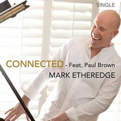 I just used Shazam to discover Connected by Mark Etheredge. http://shz.am/t304423513