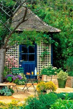 Clubhouse Ideas - Great little garden houses - another really nice one - colorful and unique; great with surrounding foliage.