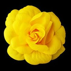 """This pretty Yellow matte satin flower with elegant ridges adds the perfect finishing touch to your hair or special occasion gown. This beautiful flower will add style and glamour to your hair or dress.    These flowers are perfect for wedding hair styles, bridesmaids up do's, prom or party hair styles.    This beautiful rose is very versatile. The back of the flower has a hair elastic or clip to easily add in your hair. .    Size: 5 1/2"""" wide by 5 1/2"""" tall"""