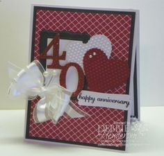 40th Ruby Anniversary by Debbie Henderson (USA-Maine) I used Cherry Cobbler Ink and a Blender Pen to color the Red Glimmer Paper darker. CS: Basic Black, Whisper White, Cherry Cobbler Acc: Organza Ribbon, Pearl Stick Pins (non-SU!) Inks: Cherry Cobbler, StazOn Jet Black DSP: Regals Paper Stack Stamps: Express Yourself, Just Sayin' Tools: Designer Frames, Scallop Heart Embosslits Die (retired), Designer Frames Embossing Folder, Modern Label Punch, Typeset Alphabet Dies, Dimensionals