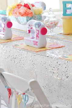 Cute scissor chair garland! Sewing themed birthday party via Kara's Party Ideas | Kara Allen | KarasPartyIdeas.com A lot of cute as a button elements, decor, cupcakes, food, games and more!