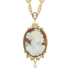 Antique Gold, Metal, Shell Cameo and Baroque Freshwater Pearl Pendant-Necklace The necklace composed of openwork scrolled fancy-shaped links, spaced by 7 yellow metal-set oval cameos approximately 16.5 x 13.8 mm., suspending one oval cameo approximately 74.5 x 47.0 mm., depicting profiles of two Neoclassical women, framed by interlocking circle links, topped by one pearl and suspending one freshwater pearl, accented by a gold scroll design. Length 26 1/2 inches.